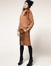 golden skirt and black beanie