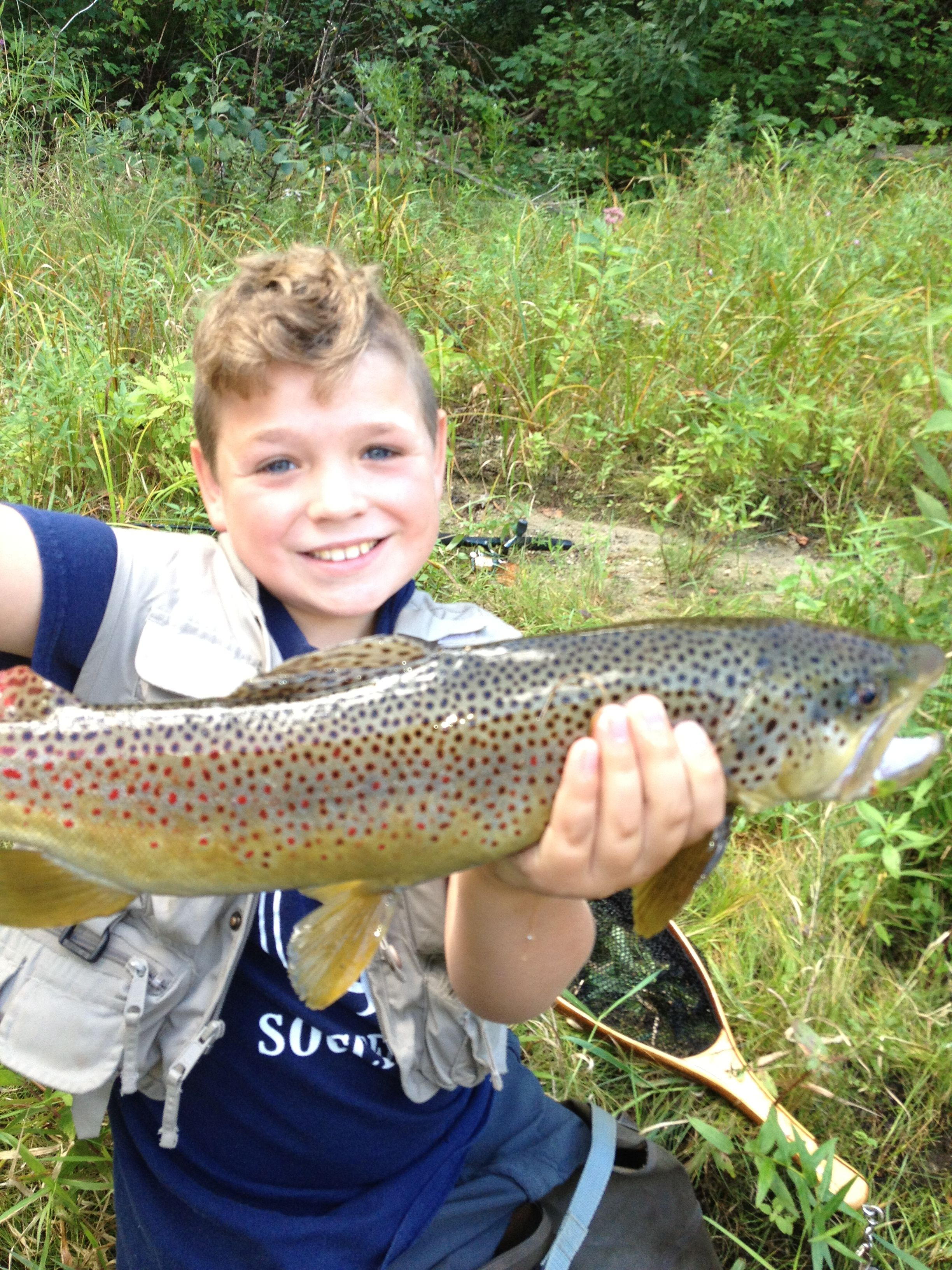 Nine year old ned caught and released a 22 brown trout for Maine trout fishing