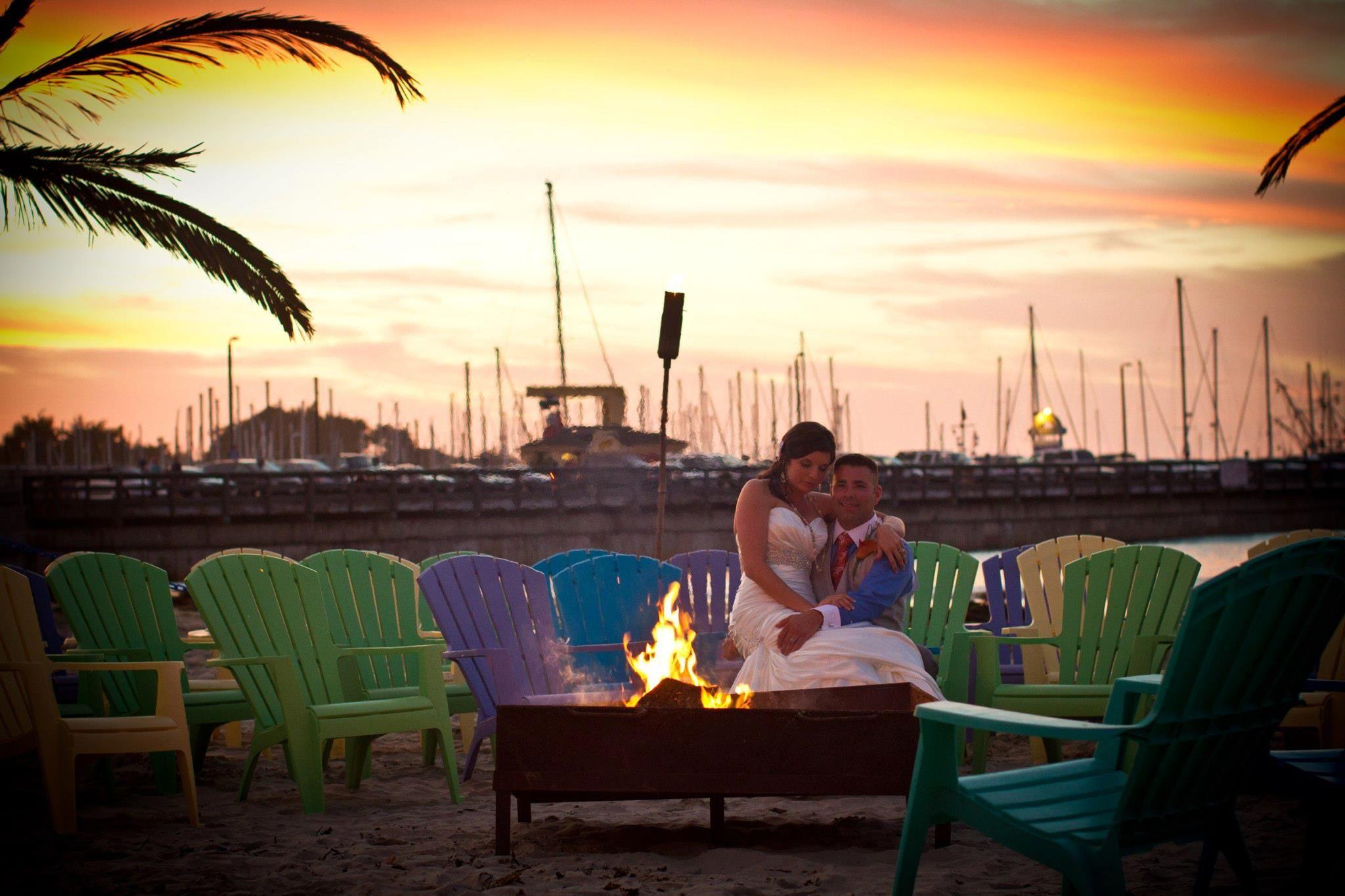 Sunrise beach wedding  BrideGroom enjoying a romantic beach bonfire after their wedding
