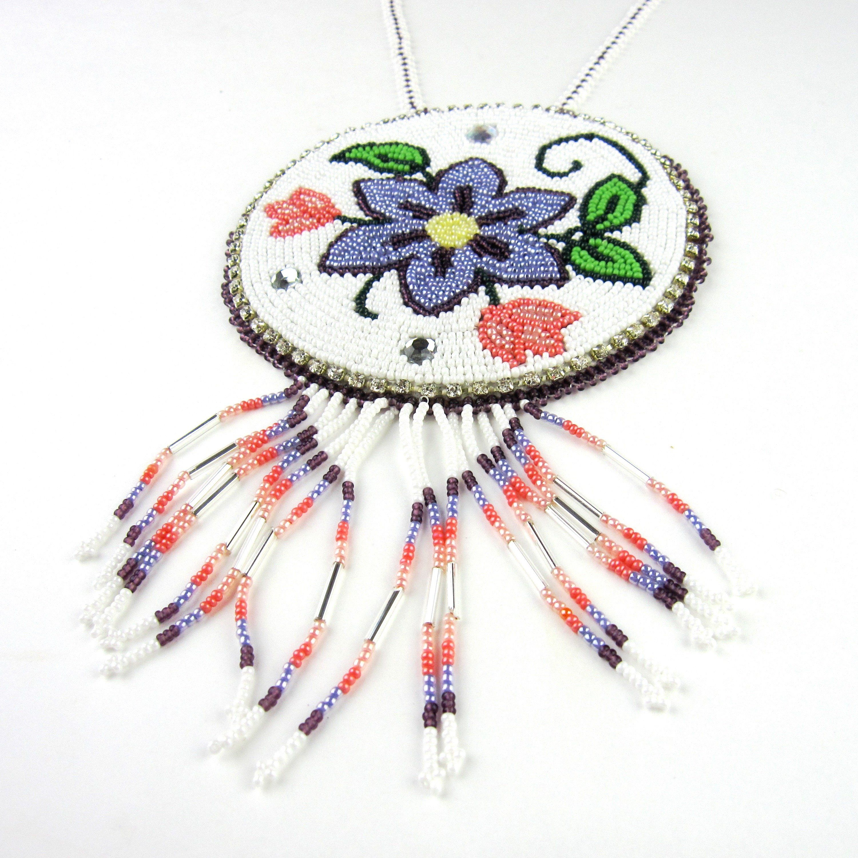 This beautiful earring and necklace set is fully beaded and features