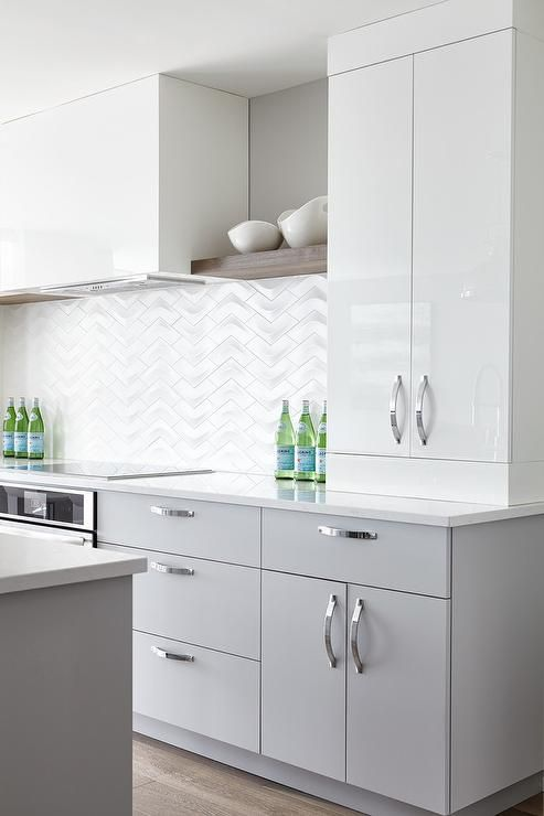 A Glossy White Hood Positioned Between Wood Shelves Is Flanked By Glossy Flat Front Whi White Glossy Kitchen Contemporary Kitchen Contemporary Kitchen Cabinets
