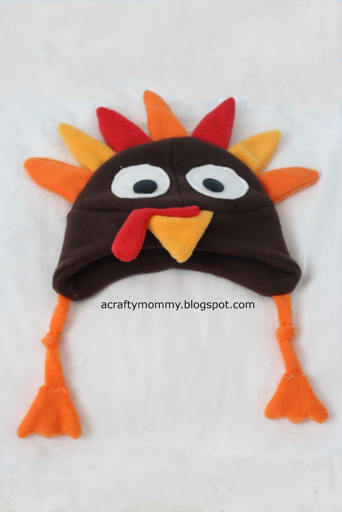 My son needed a thanksgiving hat. I used the same pattern I used to make my  dino hat only I made the spikes more feather shaped and had t. aab037cfa201