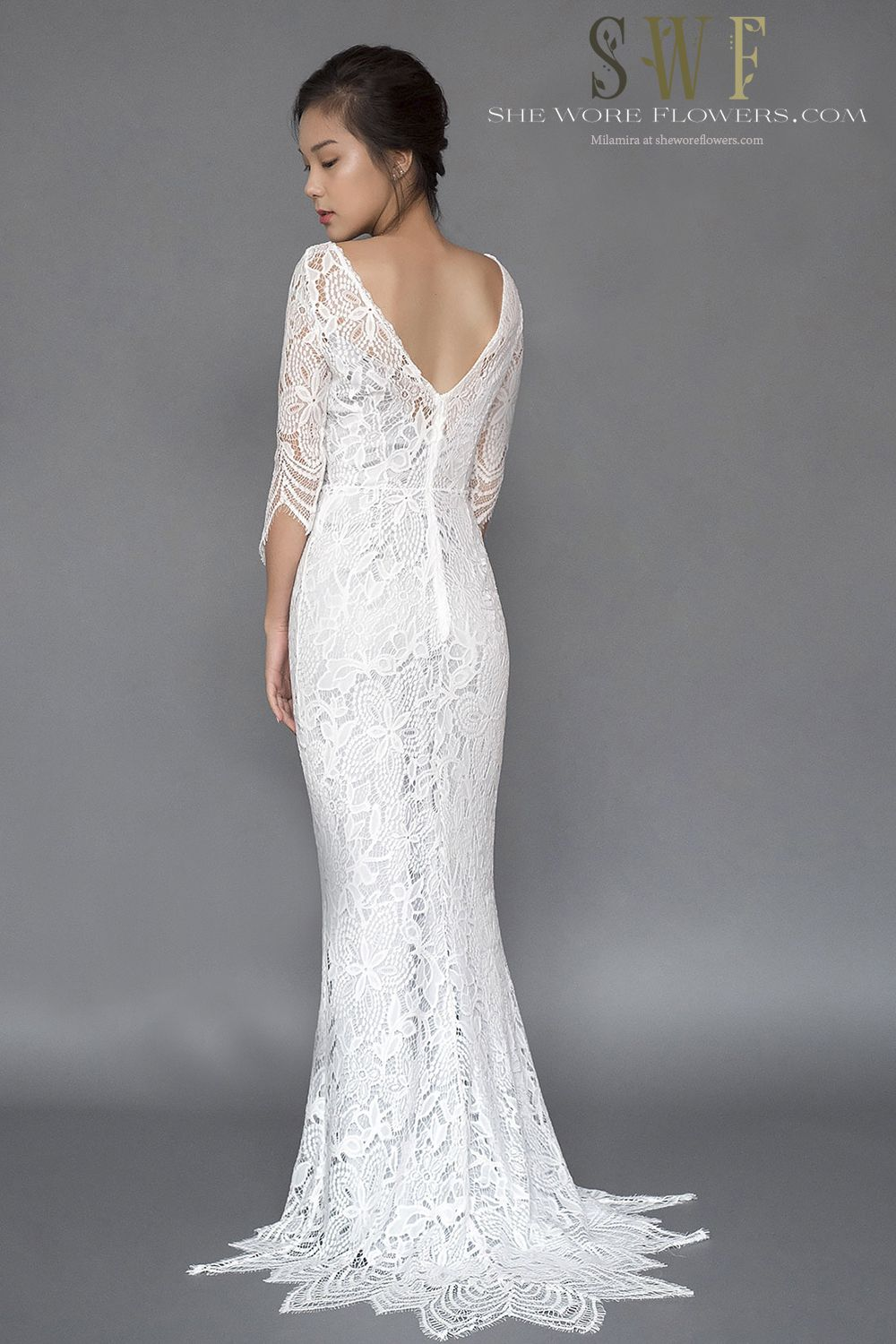 d021b66a6a27 Lace trumpet wedding dress Daytona features three quarter sleeves, a low V  back and beautiful
