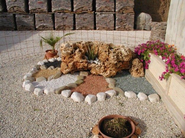 Decorare il giardino con i sassi idee fai da te for Sassi per fioriere