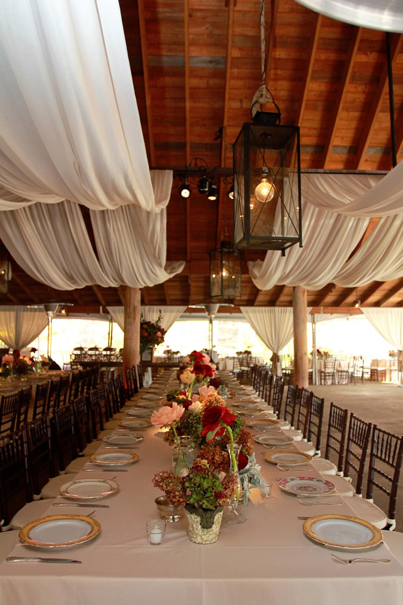 Draped fabric makes beautiful venue decoration For more ideas