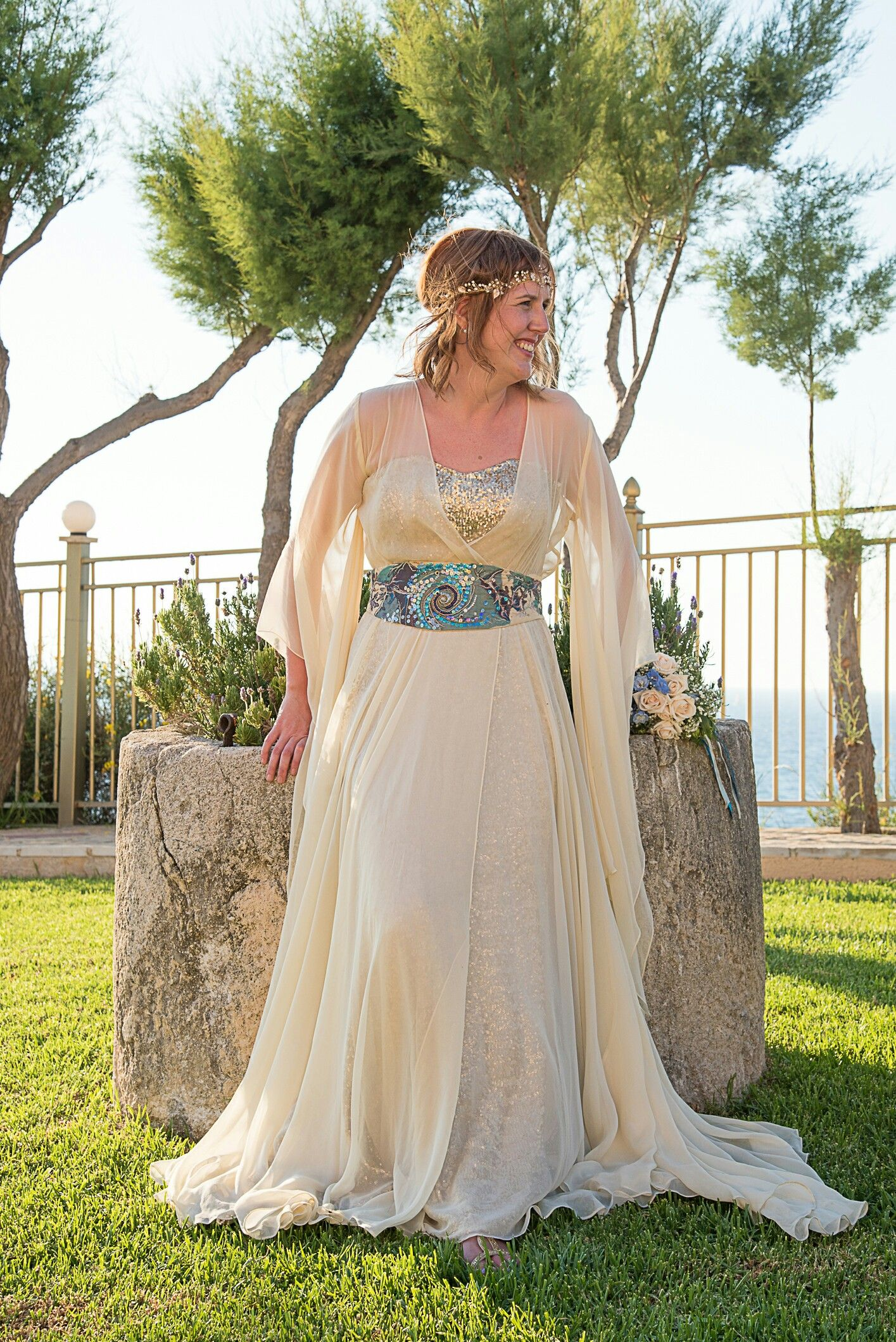 Meet Sharon our gorgeous greek goddess of a bride xx she chose our AURORA kimono and sequinned gold  dress for her Greek Islands wedding #alternativebride-  Remember it's your day your way.  #uniquewedding #goldweddingdress #vintagewedding #wedding # #alternativewedding #colourfulwedding #badassbride #rocknrollbride #rocknrollwedding #bespokeweddingdress #bespokeembroideries #bohobride #bohoeddingdress #weddingdress # kimono #aurora