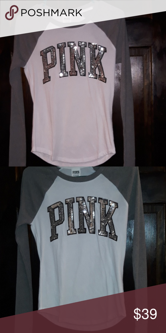 VS PINK XS RINGER L/S GRAY RIB KNIT LONG SLEEVE  WHITE WITH SILVER BLING LOGO FRONT . THE BACK.IS SOLID. BRAND NEW IN PLASTIC. TRUE TO SIZE OR EVEN RUNS SMALL***THIS TOP IS NOT OVERSIZED **** PLEASE KNOW UR VSP SIZES BEFORE BUYING AS I CAN ONLY GIVE MY OPINION  BRAND NEW ONLINE ORDER  OPENED TO PHOTO.  NOT INTERSTED IN TRADING   NO TRADES  HAPPY POSHING PINK Tops Tees - Long Sleeve
