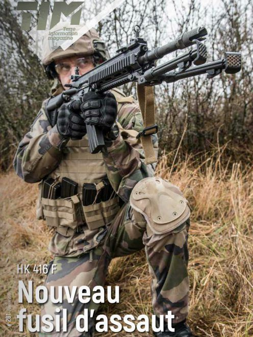 A French soldier holding a FAMAS-F1 assault rifle and a ... |French Famas Police