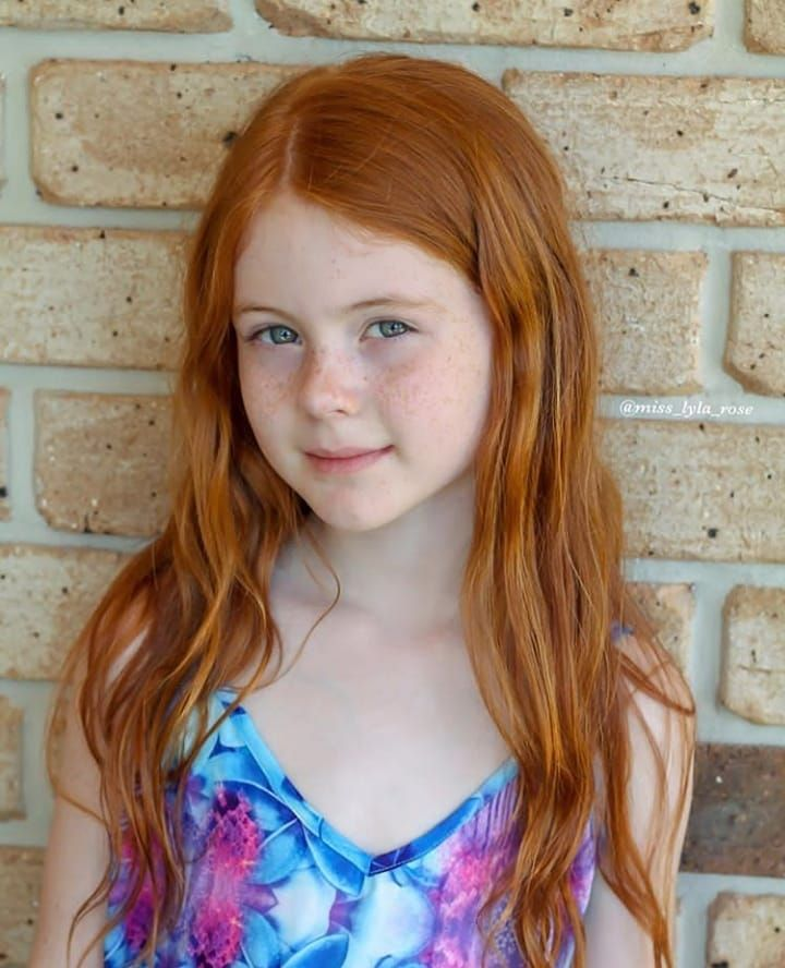 Ginger girl pre-teen, bright redhead, freckles on
