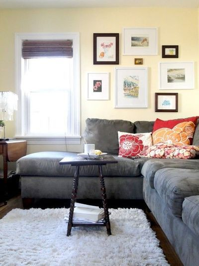 Gray couch dark floors light rug light walls red and for Dark grey couch