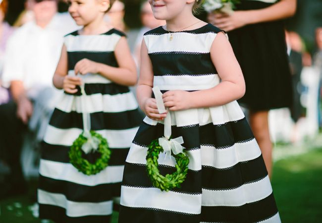 10 creative ways to make your flower girl stand out ring boys these chic flower girls are wearing black and white striped frocks and carrying bright green wreaths heather ann design and photography mightylinksfo