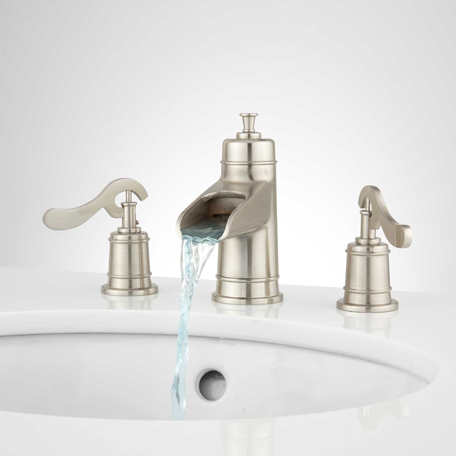Melton Widespread Waterfall Bathroom Faucet In Overflow In