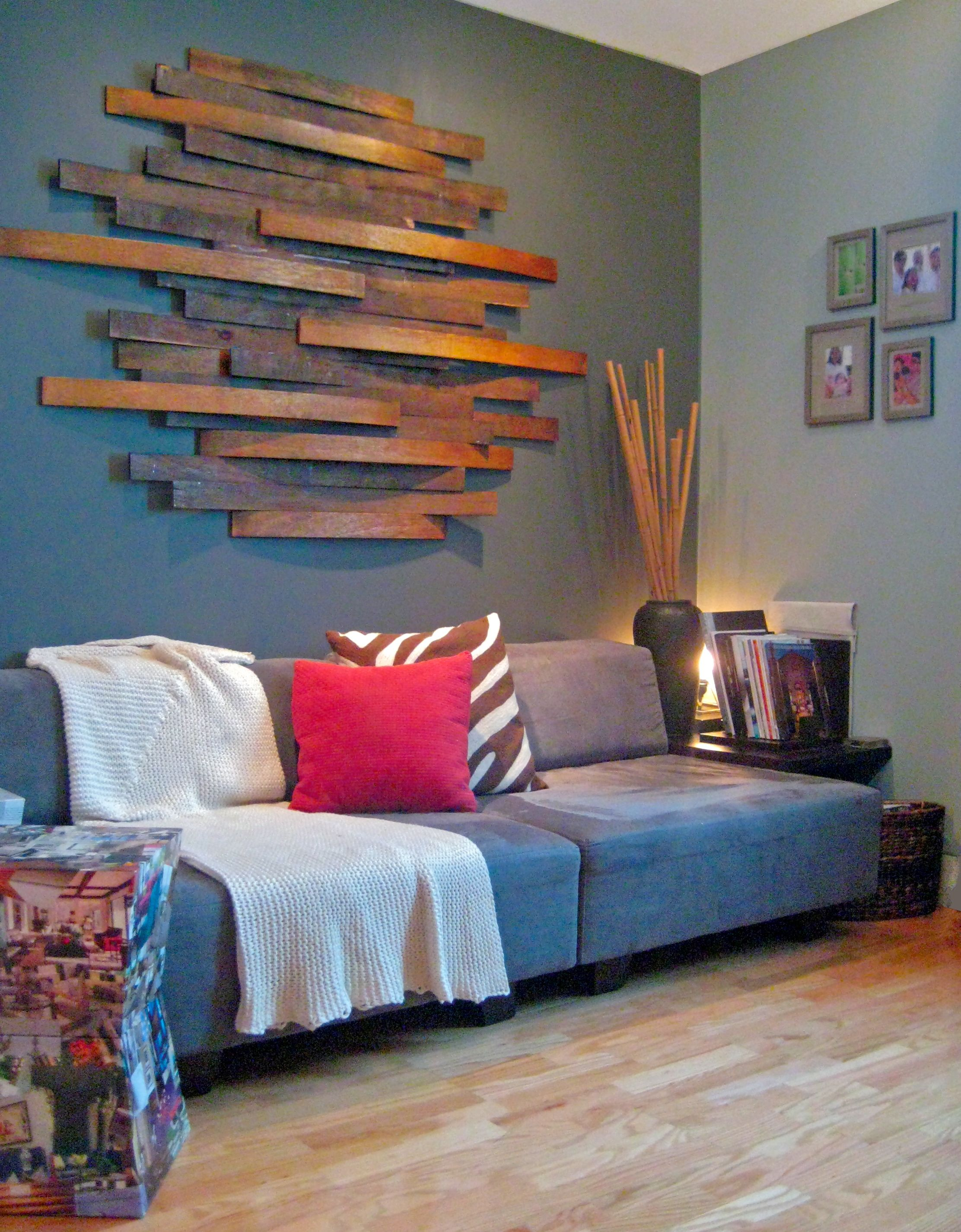 Bed wood slats staining wall mounting them randomly ud this