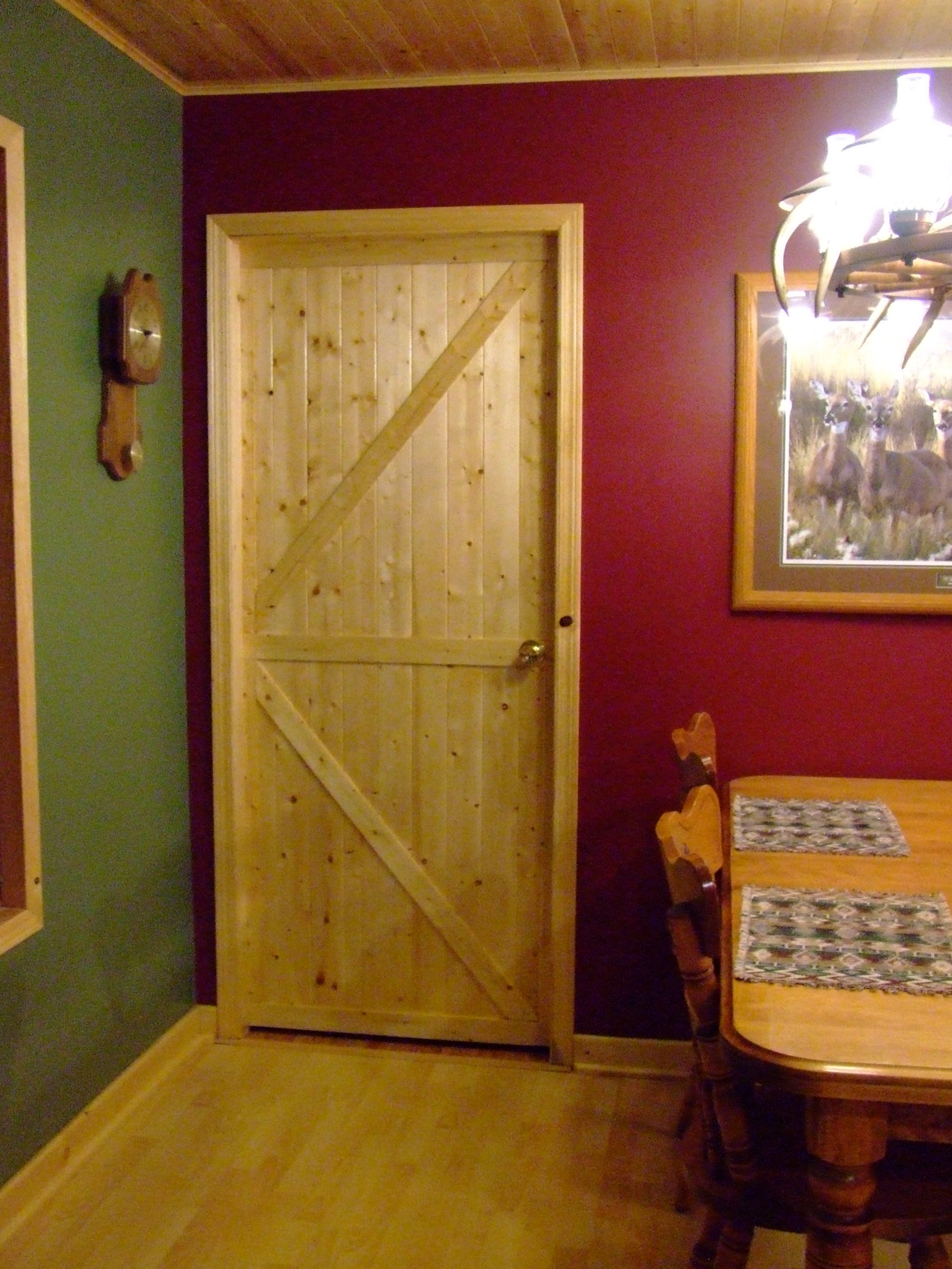 Tongue And Groove Pine Covering A Standard Door Home