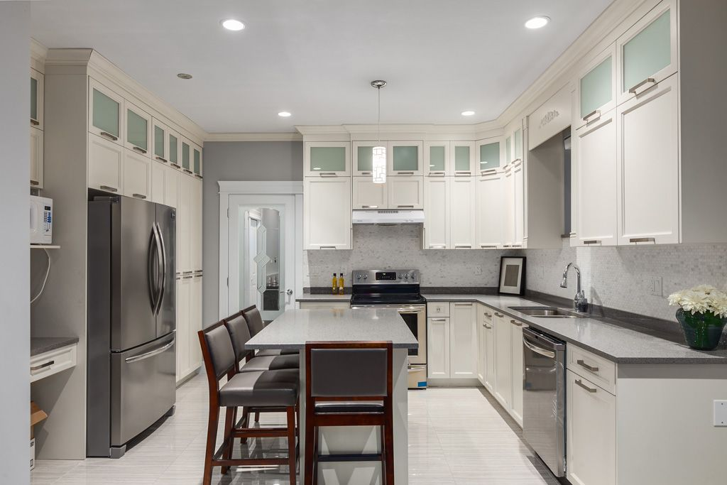 White Cabinets,sleek Grey Stone Countertops, S/S Appliances And Under Mount  Sink