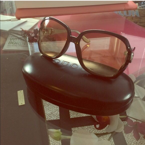 Gucci authentic sunglasses Dark brown frame light brown lenses! Lightweight sunnies purchased at Nordstroms in San Diego! Never wore these so they look practically new! GG2986/S. Great condition, does not come with this case. Will deliver them in a used Jimmy Choo white hard case though! Gucci Accessories Sunglasses