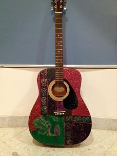 Artistic guitar painted by Seham Mousa