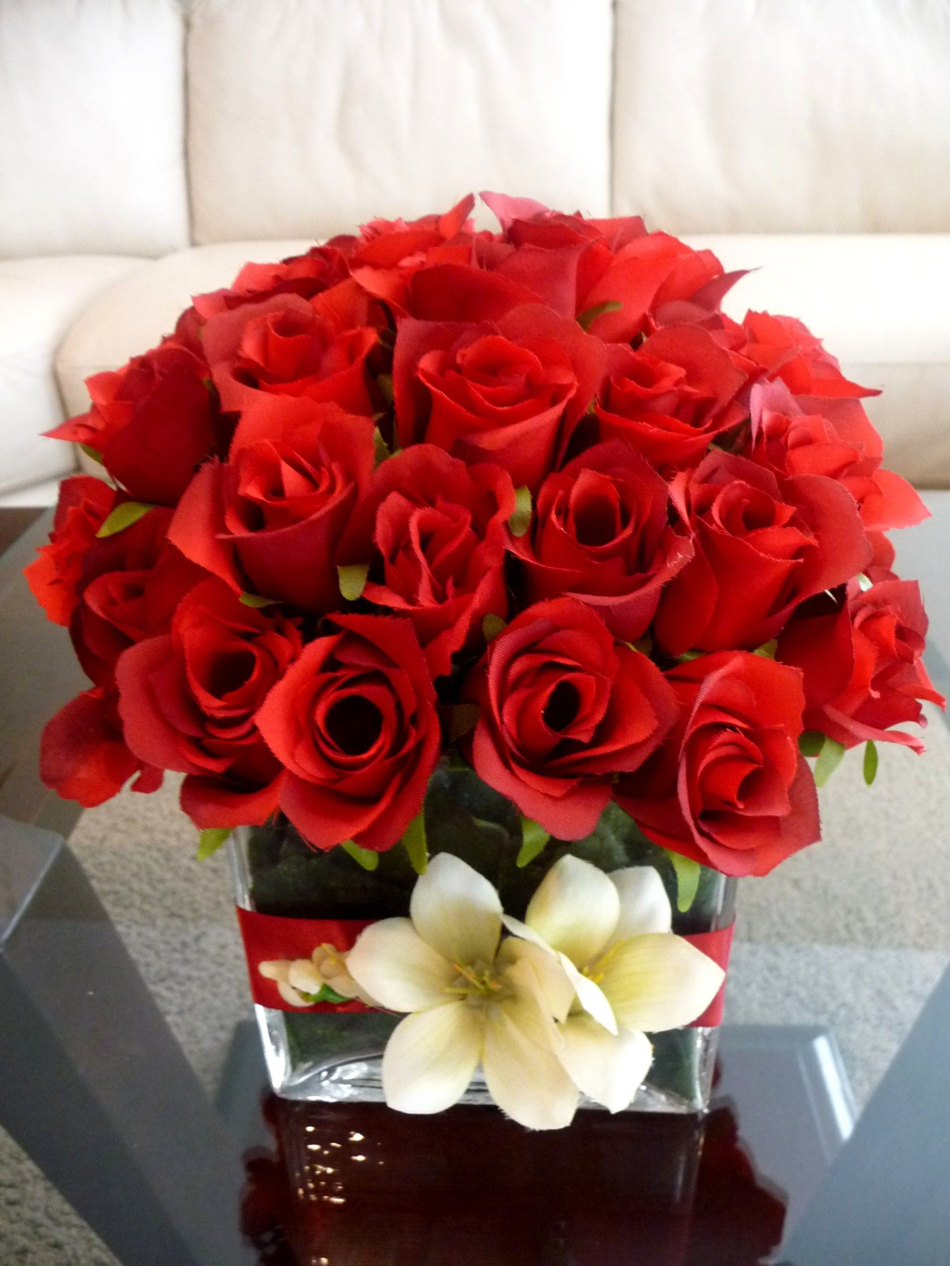 Photo via event decor red roses and floating candles red roses tightly arranged in a glass vase with a red ribbon and floral decorated vase reviewsmspy