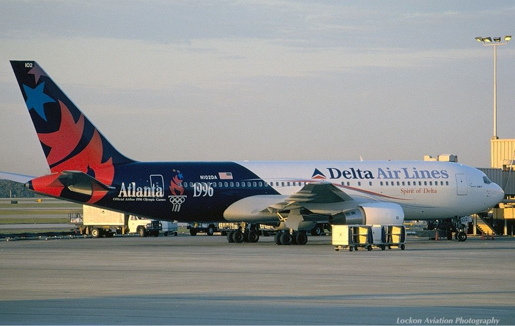 """Delta Air Lines Boeing 767-232 N102DA in """"The Centennial Spirit"""" livery at Atlanta-Hartsfield, November 1995. Delta was the Official Airline of the 1996 Olympic Games in Atlanta. This livery was also exhibited by a company McDonnell Douglas MD-11 N812DE. (Photo: Sunil Gupta)"""