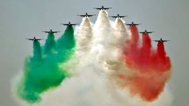 Aircraft of the Frecce Tricolori, the demonstration team of the Italian Air Force, perform during an air show in Bucharest, Romania, Saturday, July 21, 2012.  (Vadim Ghirda/AP)