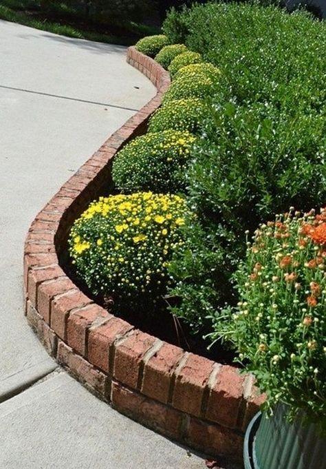 Brick flower bed edging outside pinterest bricks for Brick edging for your flower beds