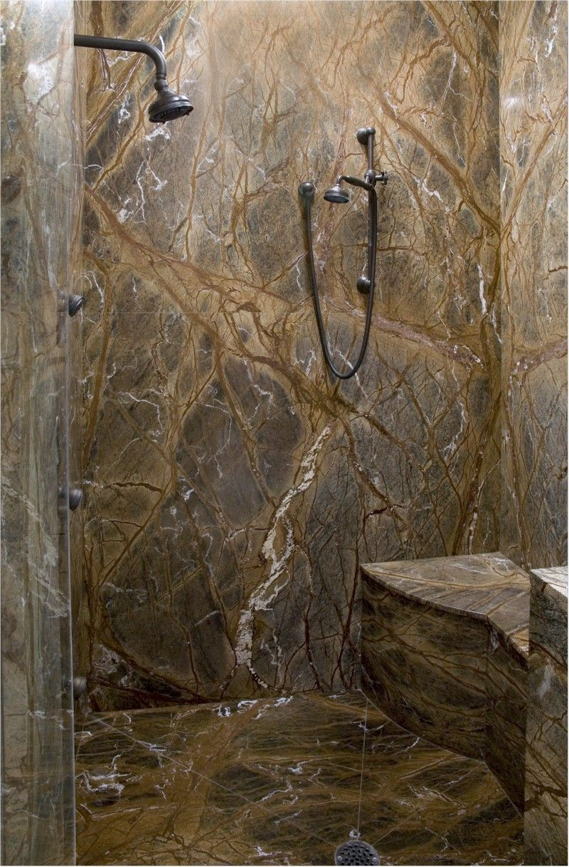Showers | Slab showers can be as simple as stone tiles or we can book match ... #bathroomtileshowers