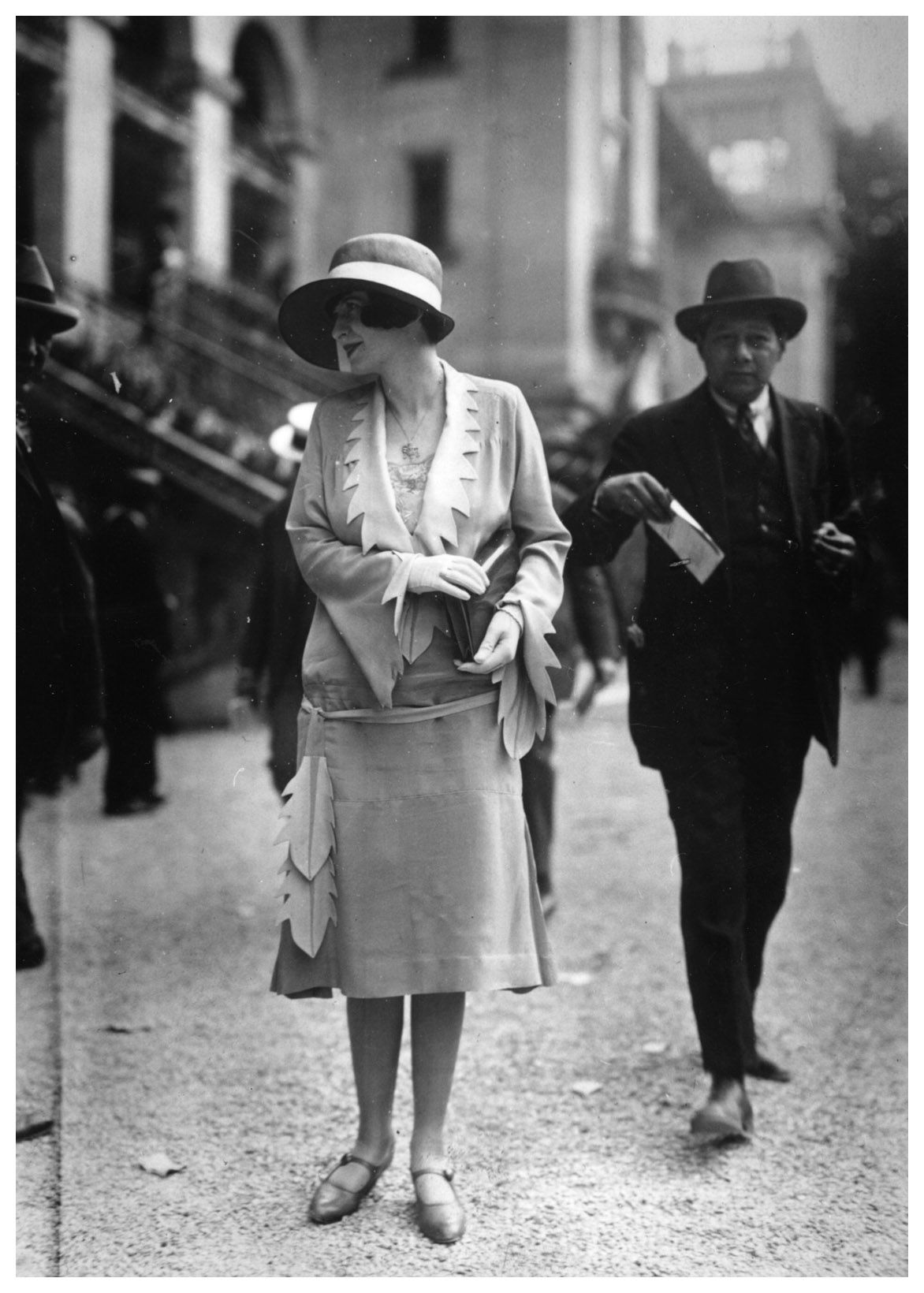 woman models the latest fashion of the day in a Paris street photo >>> photo by Seeberger Brothers, 1921