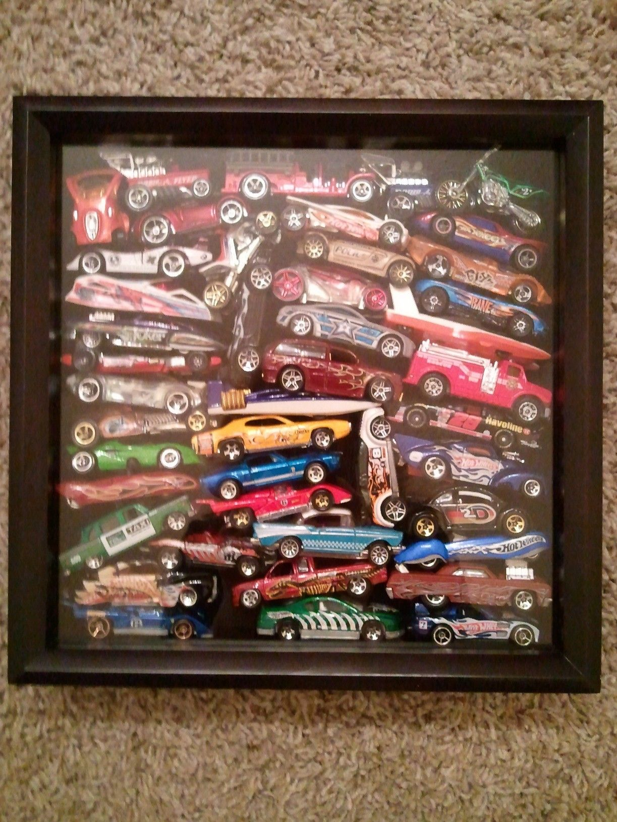 My son\'s toy cars collection in a shadow box. He loved looking ...