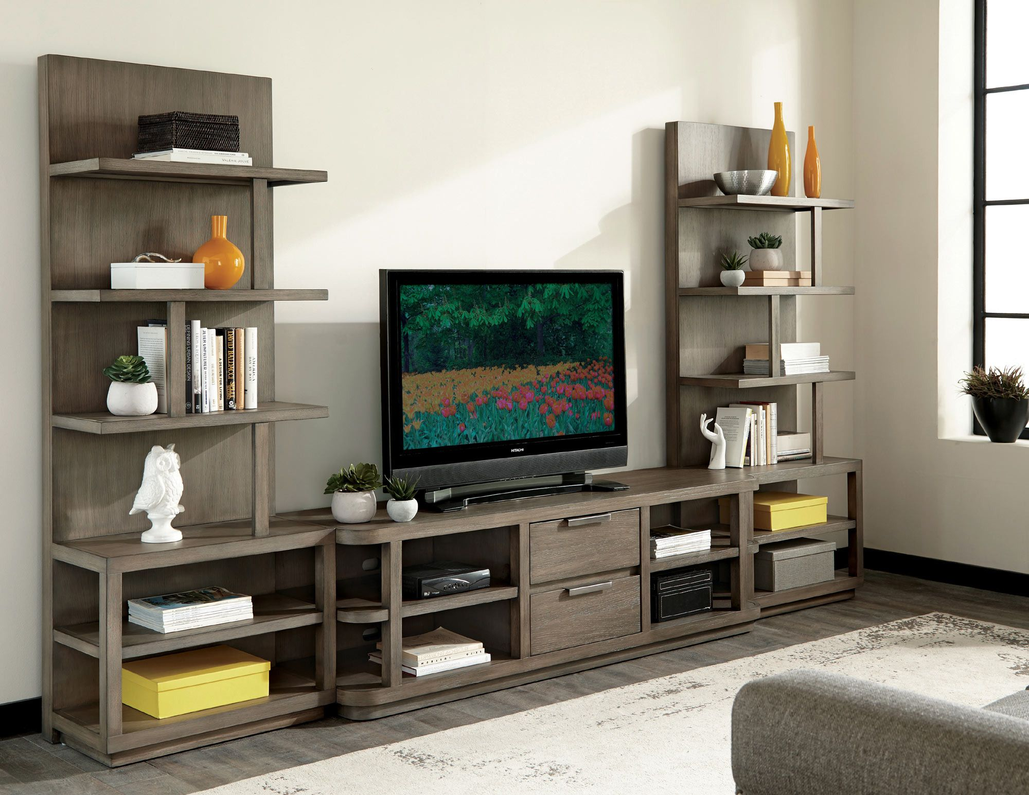 precision entertainment console with wall pier in oak riverside