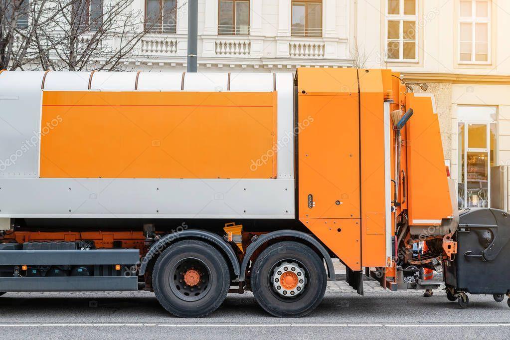 Garbage disposal lorry city street waste dump truck town