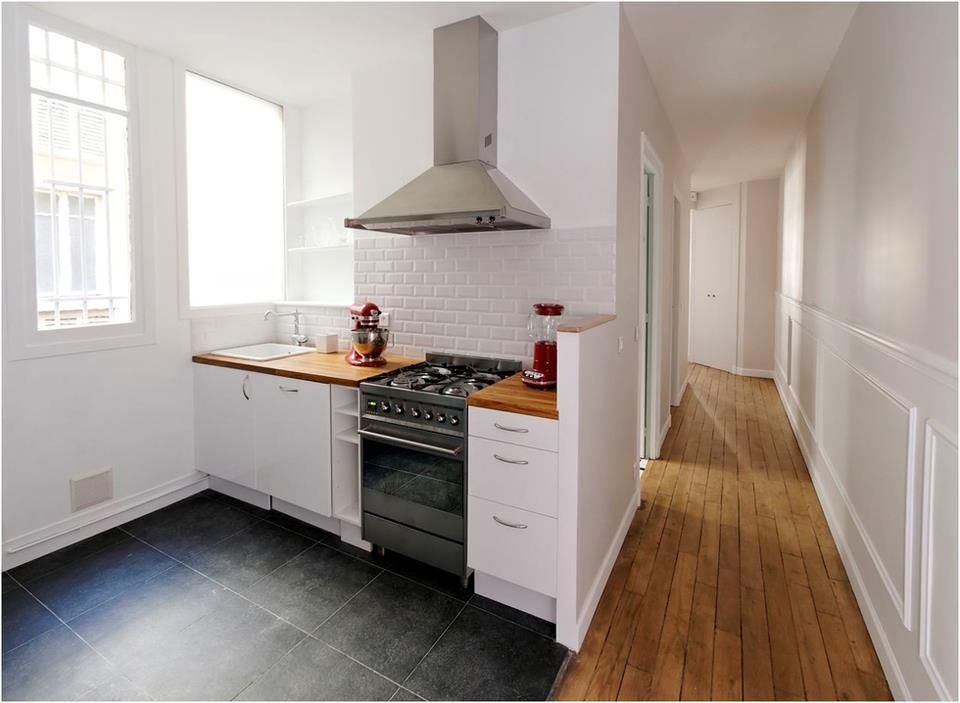 La cuisine ouvre sur le couloir pour apporter espace for Studio cuisine americaine