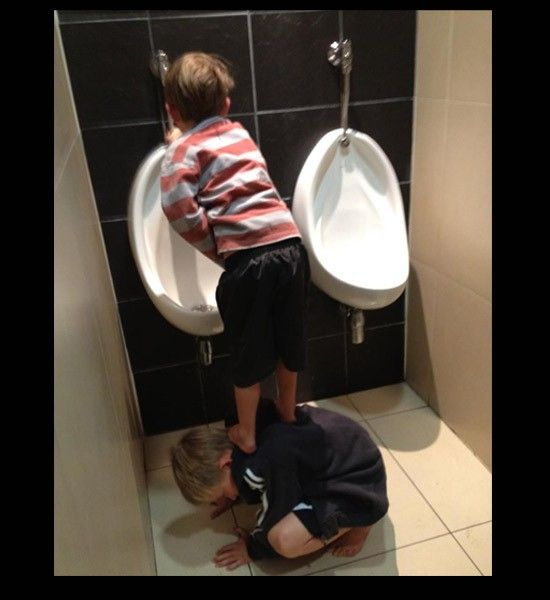 Boys peeing in urinals