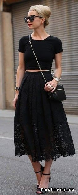 Midriff black top & black lace skirt & black bag.