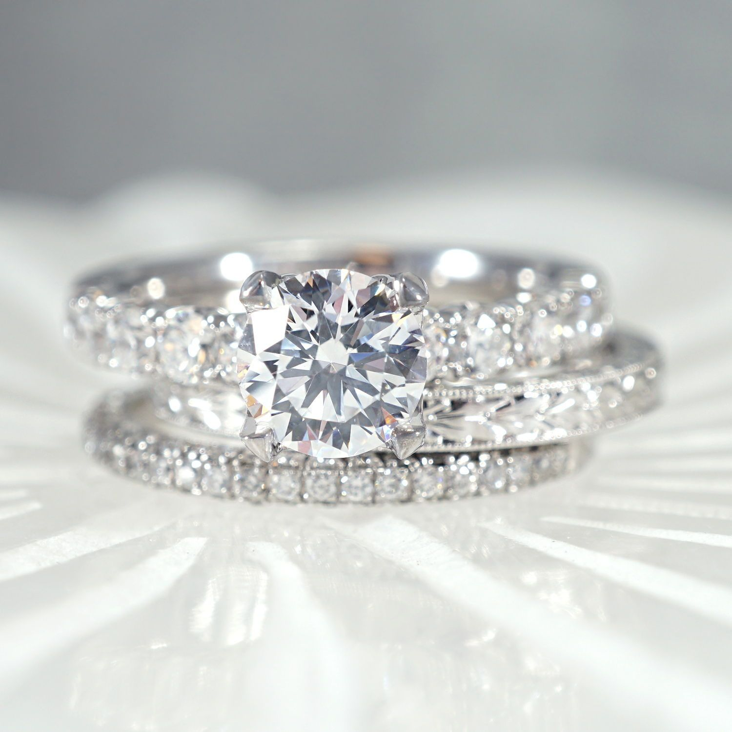 This gorgeous stack features a classic three stone diamond pave