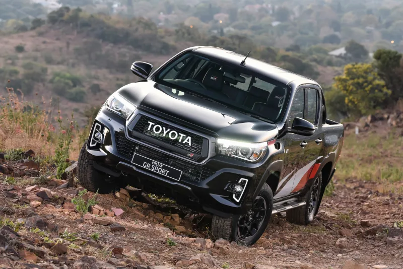 The Giant Emblem Grille On The Toyota Hilux Gr Sport Is Just The Best Toyota Hilux Toyota Hot Rods Cars Muscle
