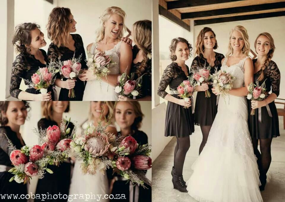 Black, lace bridesmaids dresses. Grey/silver ribbon around waist. Dress short with ankle boots. Proteas for colour. Perfect for winter