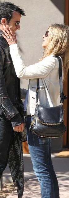 Who Made Jennifer Aniston S Black Zipper Handbag Jeans And Print Scarf