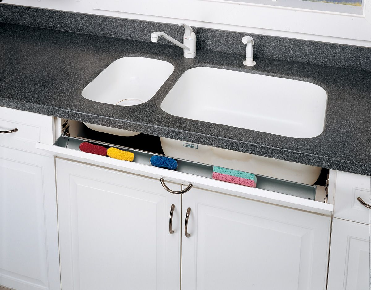 A Cabinet Tip Out Tray Right Below Your Sink Organizes Sponges And Keeps Them Out Of Sight Rev A Shelf Cabinets Organization Sink Accessories