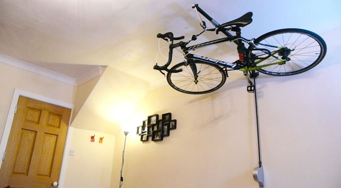Ceiling Bicycle Racks The Stowaway Lets You Store Your Bicycle Against The Ceiling Video Bicycle Storage Bike Storage Bike Storage Solutions