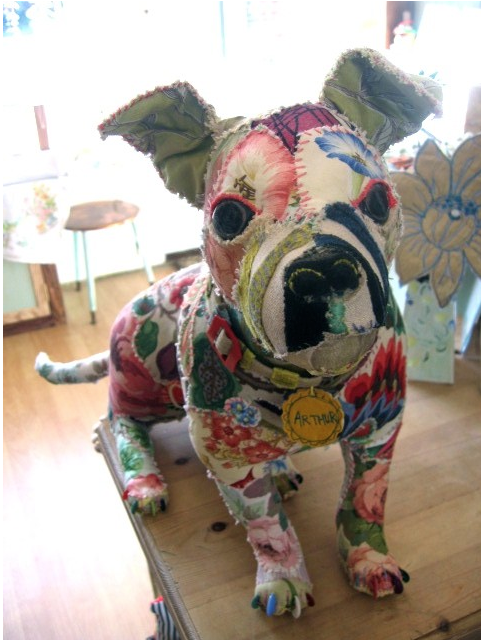 Textile animals. I totally want one... OR can I make one? I doubt mine would even look like a dog. :)