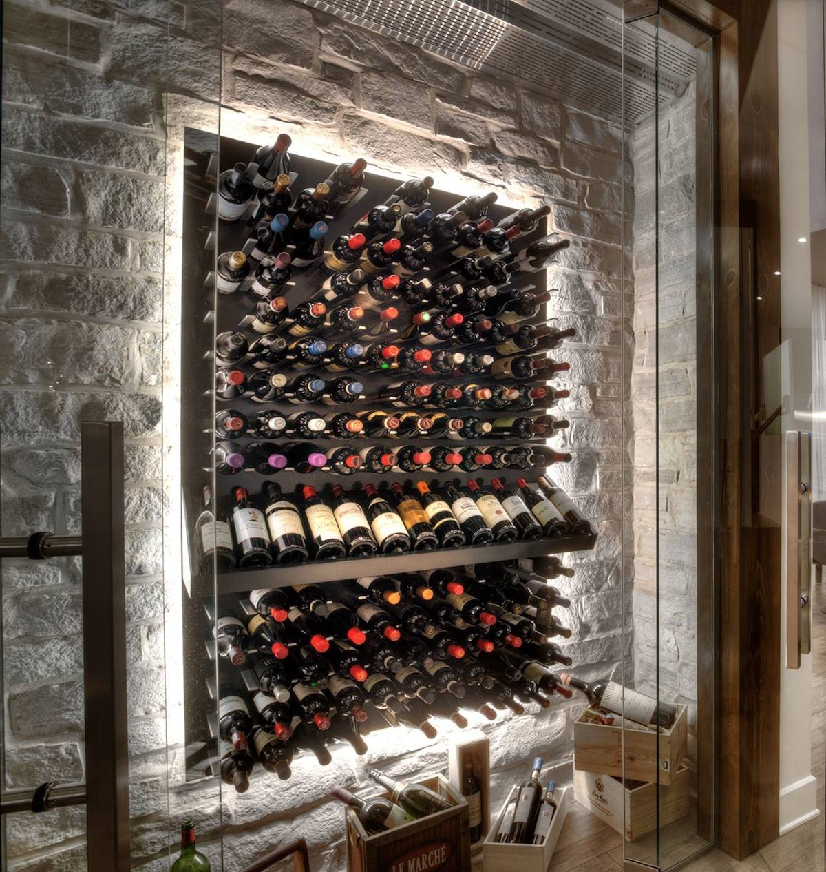 Modern wine cellar with stone wall and led back lighting for Wine cellar pinterest