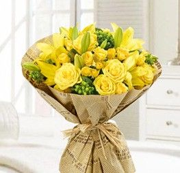 Passion Yellow Bouquet... For the love and passion of yellow flowers! We mix together the fresh yellow roses, yellow spray roses, yellow lilies touch with fresh green hypericum to create this long lasting hand tied bouquet. Please call us for details on ordering this arrangement in another color such as orange, red, white, and pink.