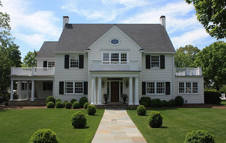 home exteriors - colonial black shutters Greek columns wraparound deck gray  shingles Gorgeous colonial home with