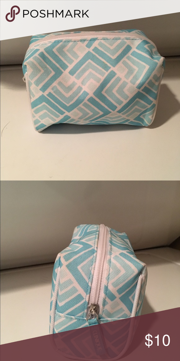 Cute Clinique make up bag Adorable blue and white Clinique make up bag. Never been used. Perfect size for quick weekend trips. Open to reasonable offers! Clinique Bags Cosmetic Bags & Cases