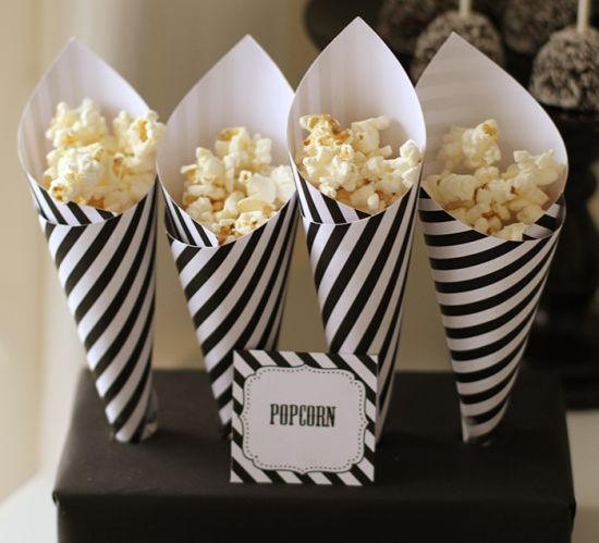 "Saw this idea related to Halloween but filling up some cute little paper cones like these with some popcorn would be super easy.  Plus, it looks great and your guests can easy grab one and enjoy!  Interested in hosting a pop-up trunk show to earn free jewelry from Chloe + Isabel? Visit my on-line boutique at http://www.LainysCandiBoutique.com and we discuss many different themes and ideas for your party. Shows can be hosted in person or on-line for you to earn ""Free Jewelry""."