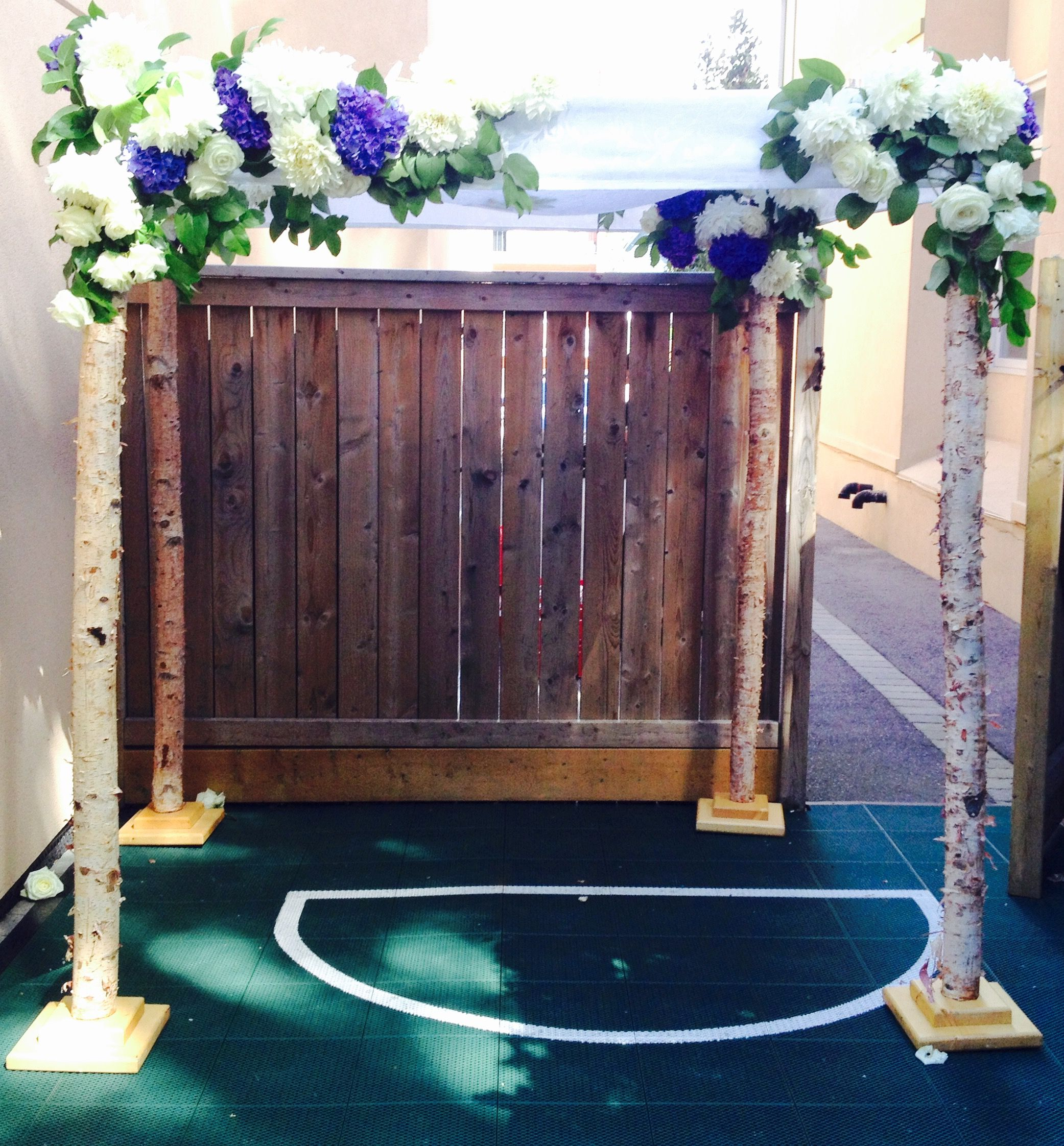 simple birch and satin top for a backyard wedding by www chuppah