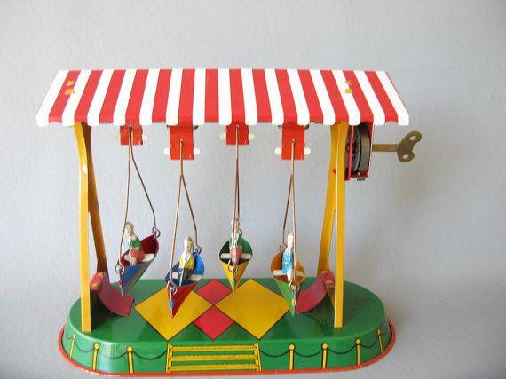 Vintage Wind up German Tin Toy Metal swing boat ride by PassedBy