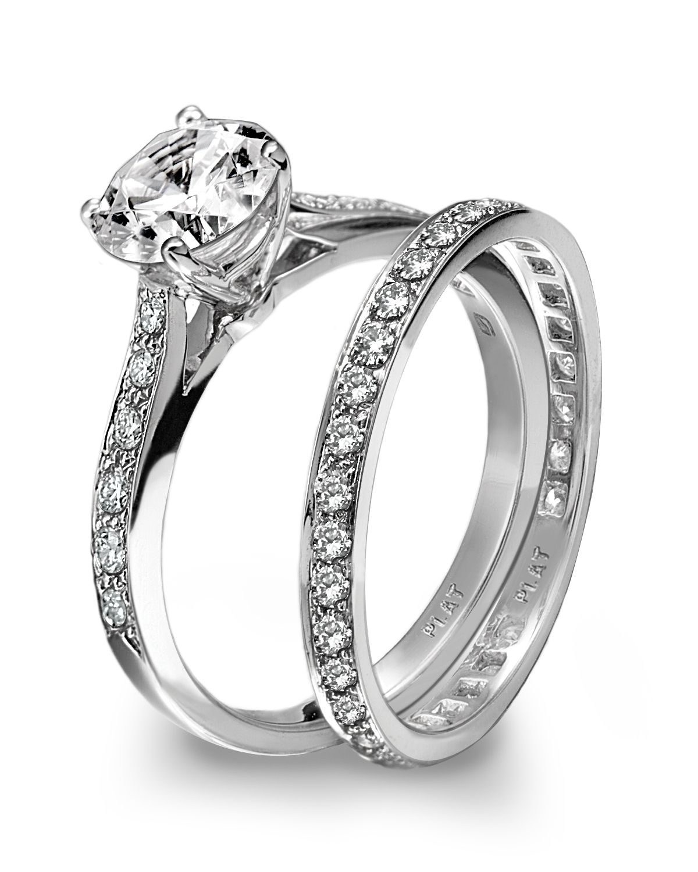 Platinum engagement ring and wedding band set. SO
