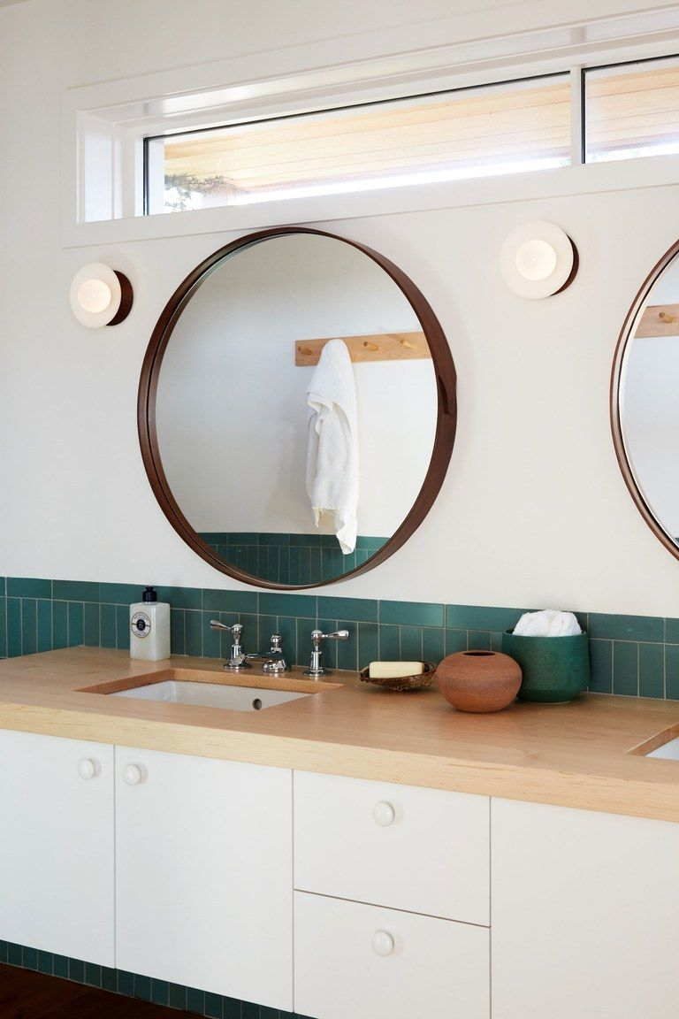 Round mirror in bathroom with green tile vanity lighting bath sconce ideas beach house