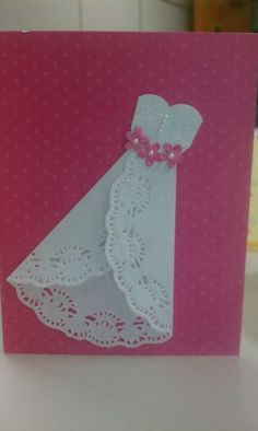 A wedding dress card made with a doily.